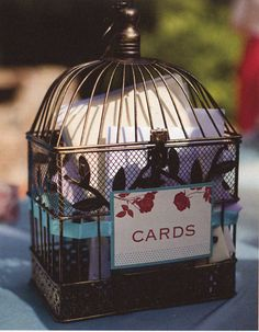 Gorgeous birdcage wedding card holder. Aqua and red wedding palette, perfect with the love bird theme.  Easy DIY for a thrifty bride.