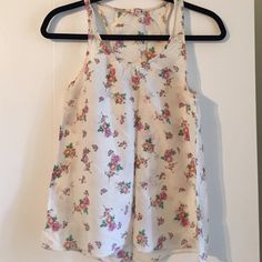 Sheer Floral Racerback Tank - Like New Lightweight sheer fabric with floral design. Racerback style. Great like new condition. Label says Medium but should fit S-M Forever 21 Tops Tank Tops