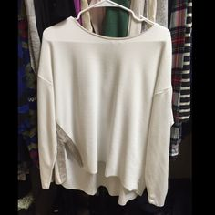 Zara long sleeve cutout top About a 4 inch slit on the side. Brand new never been worn Zara Tops Blouses