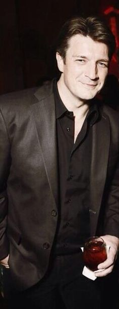 Nathan Fillion:  Sophisticated and smooth; suave