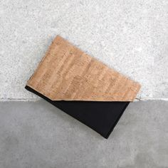 Custom handmade laptop sleeve made from real cork and neoprene fabric. With its asymmetric look and magnetic closure it is functional but also very stylish and minimalist.