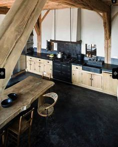 Dutch kitchen featured in LivingEtc black Limecrete and wood cupboards