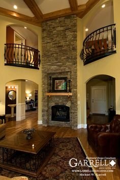 Mickey and I don't have a lot of must haves for our forever home but one of mine is a two story grand room and one of his is a fireplace. This=perfect