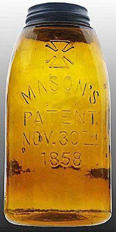 Mason's, Cross Over, Patent Nov 30th 1858, Orange Amber, 12 Gallon.A half-gallon medium amber Mason's glass fruit or canning jar with cross over Mason's Patent Nov