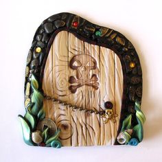 I just got this Pirate Fairy door for my boys.  It is darling!!  ClaybyKim is awesome!!