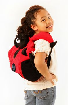 Float like a butterfly, sting like a bee...our Lula the Ladybug can do it all. Just watch her fly high as a 4-in-1 backpack, blanket, travel pillow, and plush animal companion.