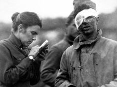 Salvation Army worker writes letter for a wounded soldier during World War I.