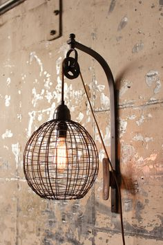 The wire sphere wall sconce with a fantastic pulley mechanism, will add interest beside the bed, mirror or in a hallway needing a lift. this rustic, metal wire and wood sconce is an inspired reminder Wall Mount Light Fixture, Wall Mounted Light, Light Fixtures, Wire Light Fixture, Pendant Lights, Wood Sconce, Wall Sconce Lighting, Wall Sconces, Wall Lamps