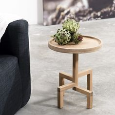 Gerard De Hoop ROOTS is a special oak side table. He firmly stands on its stylized roots waiting for you.