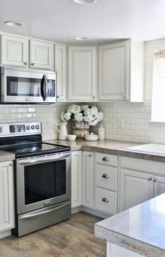 Gorgeous And Bright Light Gray Kitchens A Roundup Of Beautiful - Light gray painted kitchen cabinets