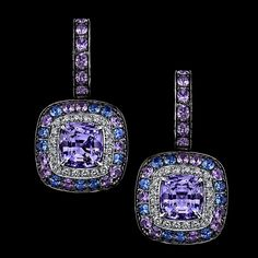 Robert Procop Exceptional Jewels ~ Violet Sapphire American Glamour Earrings- A pair of cushion violet sapphires weighing over 9 carats are expertly set into an 18k white gold mounting. Adorning the center stones are a combination of violet and blue sapphires