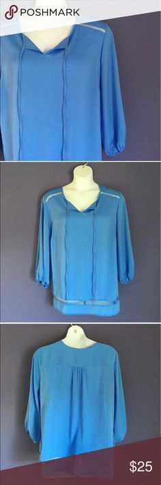 """Violet & Claire Blue Blouse Going on a trip?  This top should be with you!  The blue color is beautiful.  The shoulders and bottom have a """"peek-a-boo"""" strip.  Pair with jeans or white capris.  Measurements (Flat):  Length - 30.5""""/Bust - 28""""/Waist - 27"""" Violet & Claire Tops Blouses"""