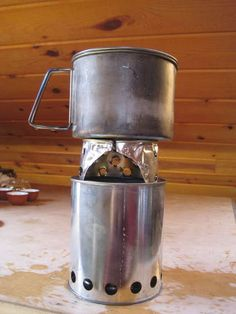 Directions for making a double walled wood stove out of a small paint can.