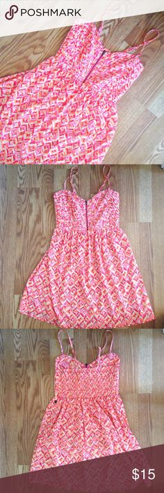 HP 6/25  Roxy Tank Top with Zip Front Roxy tank top with zip front, adjustable straps and elastic back. Color: cream with pink and orange. Size: M. This top is fitted along the bust and then flowy everywhere else. Perfect tank for the summer! Roxy Tops Tank Tops