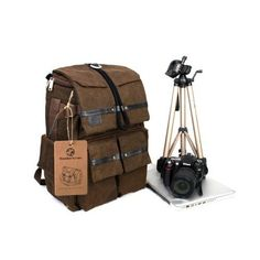 Koolertron Waterproof Canvas DSLR SLR Camera Laptop Backpack. This would be perfect for carrying both my camera gear and Apple Macbook Pro Retina.