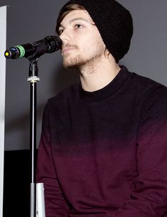 Louis at the charity event Rays Of Sunshine in London.THE BEANIE!! the scruff!!