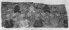 Textile fragment  second half of 14th century DIMENSIONS 165 x 43  Fragment of salmon silk self-patterned with vine, brocaded with green and white silk and gold-metallic thread with dragons (wings are inscribed with DRAGO) above rows of trees with small animal and birds under each tree.