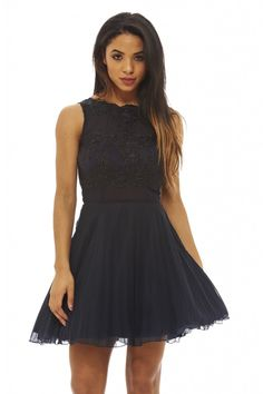 This navy skater dress is a stunning party piece that'll draw all eyes to you! This sleeveless style with its crochet lace and mesh top as well as its kick out pleated skirt will flatter any figure. Simply pair with some killer heels for a show stopping look!