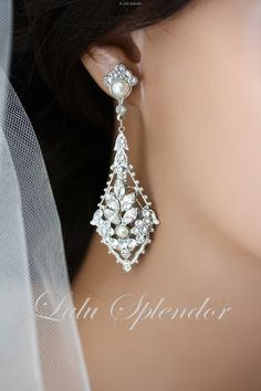 Art Deco Wedding Earrings available in Rhodium and Gold finish, with or without pearl accents.