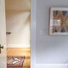 Clean look. Love the art work echoing lines of rug...