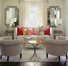 Great layout, wonderful mirrors, colorful pillows, neutral furniture, walls & drapes. Not much to it but so nice.