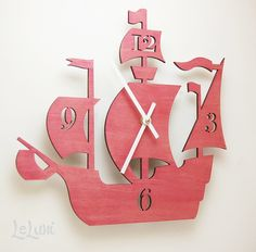 """I have a sister who is actually a bona fide """"Dread Pirate Roberta"""". This would be perfect in black for her.     The """"Dread Pirate Roberta"""" in Princess Pink, a designer wall mounted clock from LeLuni. $52.00, via Etsy."""