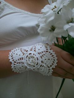 Wedding Cuffs Lace Wedding Accessory Bridal by WomanAccesories on Etsy.. those are cute, i like them alot but depending on how far my sleeves comedown, it might be too much. idk.. but very pretty and very vintage!!