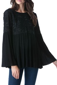 Romantic Black top Long sleeves Black embroidery detail on bodice and back tie detail.  Black Romantic Top by Patty's Closet. Clothing - Tops - Blouses & Shirts Clothing - Tops - Long Sleeve Las Vegas