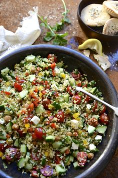 A zesty Tabbouleh inspired bulgur wheat salad with chickpeas, feta and sweet peppers with mint and rocket - an easy recipe for healthy summer salads