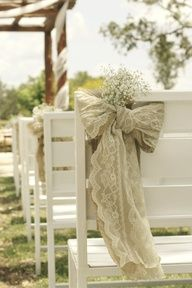 big burlap & lace bows add a soft touch to this ceremony area