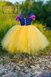 Simple Halloween Costume for Snow White.  Add Red bow to hair and spray hair black.  This came from an etsy.com sell item.