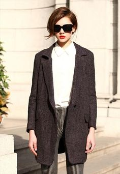 Boyfriend coat, oversized shades, 'schtick.
