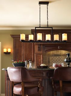 Could do something like this over kitchen table if you want casual look?  Luminous Candel Chandelier & Wall Sconce Kitchen