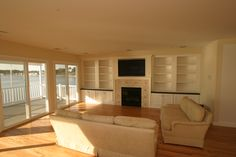 Open living room with custom built in bookcases.