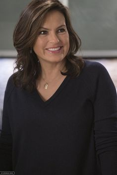 Mama Benson; black top, necklace