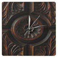 Wooden Carving Clock ~   This decorative clock features a photographic image of a beautiful artistic wood carving in shades of brown, gold, mahogany and black. A central abstract circular flower pattern has petals radiating out to a carved circle which is surrounded by four sections. Each section has abstract leaf carvings.