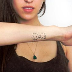An Elephant Tattoo design is generally considered a symbol of good luck. In fact, elephants are often collected by people – like pigs and frogs – because in many Like Details – delicate Serpiente por Tattooist Greem – Tatuajes para Mujeres Tatuagem Hand Tattoos, Forearm Tattoos, Small Tattoos, Crow Tattoos, Phoenix Tattoos, Tiny Elephant Tattoo, Elephant Tattoo Design, Mother Daughter Tattoos, Tattoos For Daughters