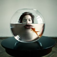 """Inventive photography, strange reflection, refraction to enlarge lips in fishbowl. Such a lovely use of framing and black and white photo. """"Only a Kiss"""" by Maria Frodl. Conceptual Photography, Creative Photography, Portrait Photography, Histogram Photography, Photography Magazine, Street Photography, Contemporary Photography, Fish Eye Photography, Wedding Photography"""