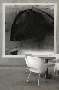 Isabella Trimmel's abstract artworks in black and white make a great statement. Here in an open setting with modern white furniture. Find more at www.art-y-sana.com