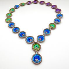 This is a free crochet pattern for my Peacock Eye Necklace design.