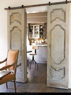Elegant yet rustic doors on barn glide track. Love it!