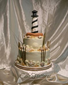 """Cape Hatteras Lighthouse Cake ~ 8"""" 5"""" iced with buttercream and accent with white chocolate and chocolate seashells"""