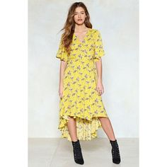 Nasty Gal Finish It Off Floral Dress (1.137.950 VND) ❤ liked on Polyvore featuring dresses, yellow, floral wrap dress, ruffle wrap dress, floral print dress, hi lo dresses and wrap dress