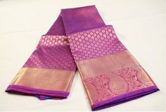 A rich plum purple pure kanchipuram silk saree with a stunning broad border of mango/paisley design and burnished gold. The body and pallu/fall of the saree are richly adorned with traditional zari designs. Sari Dress, Saree Blouse, Indian Attire, Indian Outfits, Bridesmaid Saree, Silk Cotton Sarees, Kanchipuram Saree, Temple Jewellery, Jewelry
