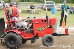 Texas T-Rex at work during the Bonham Heritage Day LSGTPA tractor pull - Ashley Jesko Photography