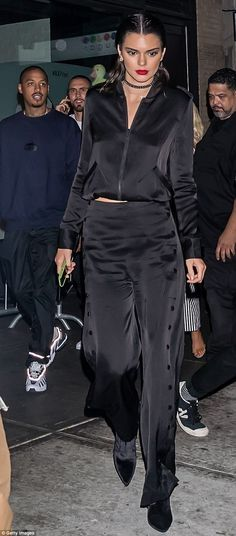 Chic out: Kendall looked striking in her all-black ensemble and bright red…