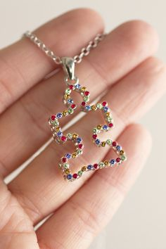 Our silver-tone pendant mimics the hope bursting from your heart for autism awareness. The classic multi-colored puzzle piece is done up in glittering crystals, set deep in a 3D cast for a stand-out look.