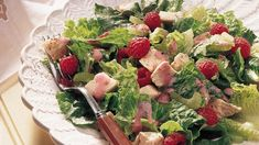 Fresh raspberries add a delectable sweetness to both the creamy dressing and crunchy salad.