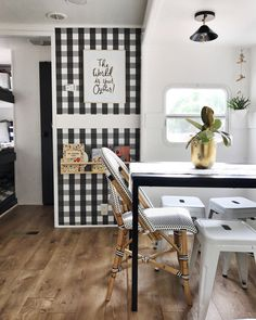 black and white wallpaper in a fun, tiny dining space