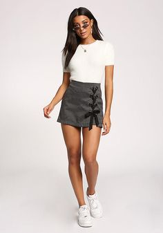 87863cb681 A trendsetting skort that features side lace up straps with 2 rows of  grommets. In a woven bodice with a glen plaid print a thin back zipper ...